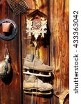 Small photo of antique old style retro object assemblage on a wooden wall. rustic stile. Clock, bell, old skates and others