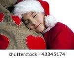 Tired santa boy - stock photo