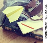 Small photo of retro suitcase old favorite camera and flight plan / dream of air travel