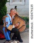 street musician  ethnic male ... | Shutterstock . vector #433474135