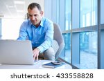 handsome businessman sitting at ... | Shutterstock . vector #433558828