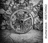 Old Wooden Cart Wheel Against...