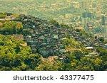 Favela or slum seen from Corcovado - stock photo