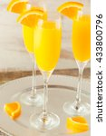 Small photo of Homemade Refreshing Orange Mimosa Cocktails with Champaigne
