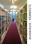 bookshelves full of books.  | Shutterstock . vector #433860172