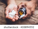 bottle pouring pills on a male... | Shutterstock . vector #433894552