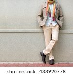 fashionable man in beige... | Shutterstock . vector #433920778