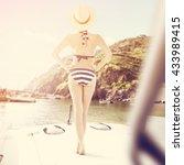 slim woman and blue bikini    Shutterstock . vector #433989415