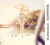 boat woman in blue bikini and...   Shutterstock . vector #433989508