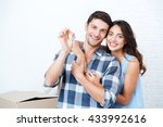 young smiling couple showing... | Shutterstock . vector #433992616