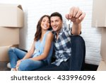young married couple with boxes ... | Shutterstock . vector #433996096