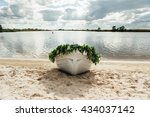 lonely white boat on the bank... | Shutterstock . vector #434037142