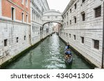 VENICE, ITALY - JUNE 04, 2016 -  tourists taking photographs during romantic trip in a gondola in the canals of Venice Italy