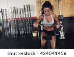 fitness woman on bicycle doing... | Shutterstock . vector #434041456