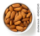 Bowl Of Whole Almonds Isolated...