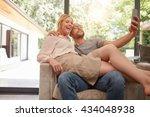 indoor shot of loving couple...   Shutterstock . vector #434048938