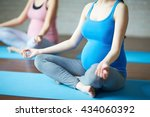 pregnant woman practicing yoga | Shutterstock . vector #434060392