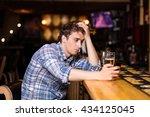 Sad Single Man Drinking Beer A...