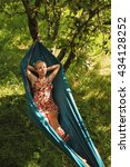 woman laying in hammock and... | Shutterstock . vector #434128252