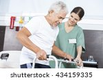 nurse looking at patient using... | Shutterstock . vector #434159335