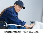 woman technician fixing an... | Shutterstock . vector #434169226