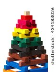 Small photo of Close up of a pyramid made with colorful pieces of wood. Toy for learn the creativity and dexterity. Isolated on white