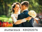 the bride and groom hugging and ... | Shutterstock . vector #434202076