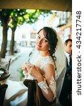beautiful bride drink coffee at ... | Shutterstock . vector #434217748