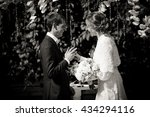 bride tries to put a ring on... | Shutterstock . vector #434294116