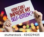 Small photo of How Can I Improve My Self-Esteem? placard with night lights on background