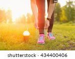 woman lacing running shoes... | Shutterstock . vector #434400406