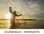fisherman repairs the fishing...