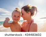 smiling laughing mother baby on ... | Shutterstock . vector #434483602