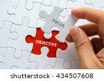 hand holding piece of jigsaw... | Shutterstock . vector #434507608