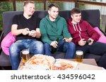 young men drink beer  eat pizza ... | Shutterstock . vector #434596042