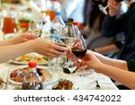 hands holding glasses and... | Shutterstock . vector #434742022