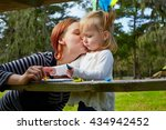 mother kissing daughter drawing ... | Shutterstock . vector #434942452