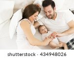 Happy Family With Newborn Baby...