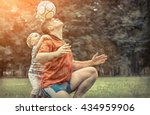 father and son playing football ... | Shutterstock . vector #434959906