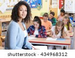 portrait of teacher in class... | Shutterstock . vector #434968312
