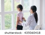 pediatrician with child in... | Shutterstock . vector #435060418