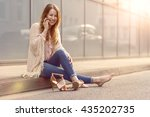 trendy young woman sitting on... | Shutterstock . vector #435202735