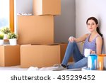 woman in a new home with... | Shutterstock . vector #435239452