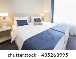 Stock photo double bed hotel room interior in the morning 435263995