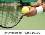 Tennis Player Holding Racket...