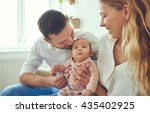 proud mother and father smiling ... | Shutterstock . vector #435402925