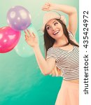 Small photo of Joy and carefree. Lovely gorgeous smiling girl playing with colorful balloons. Young cute happy woman have fun in summer time.