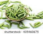 Green Peas On A Blue Wooden...