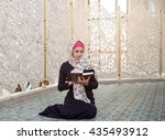 woman praying in the mosque and ... | Shutterstock . vector #435493912