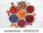 various fresh fruits in bowls... | Shutterstock . vector #435521275